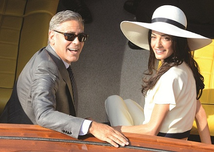 George Clooney and his wife Amal Alamuddin leave the city hall after their civil marriage ceremony in Venice, Italy, Monday, Sept. 29, 2014. George Clooney married human rights lawyer Amal Alamuddin Saturday, the actor's representative said, out of sight of pursuing paparazzi and adoring crowds. (AP Photo/Luigi Costantini) ** Usable by LA, DC, CGT and CCT Only **