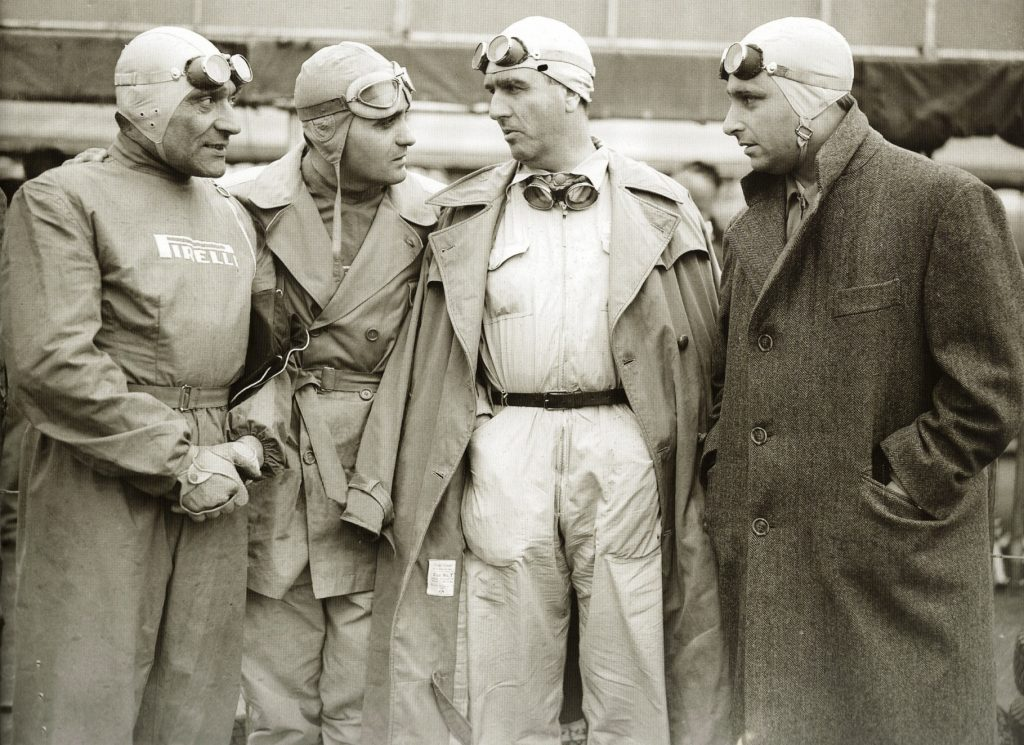 The pilots of the early F1, with coveralls, goggles and aviator helmets.